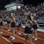 The Trinity University cheerleaders stand at attention during Saturday nights game against Howard Payne. The cheerleaders set up shop on the track where they remained all game cheering the Tigers to victory.