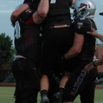 Senior tightened, Mason Lytal celebrates with his teammates after scoring a touchdown. Lytal had five catches in the game and four touchdowns, tying the school record.