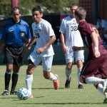 Yuri Ribeiro dribbles the ball around a Williamette defender to help lead the tigers to victory. The victory added another win to their undefeated season.