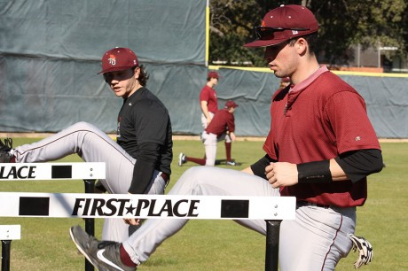 First year Mike Speanburg and sophomore Teddy Croft warm up during practice as the men's baseball team prepares for the upcoming season. Photo by Sarah Cooper.