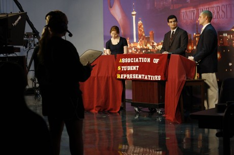 Kelsea Yarbrough, TigerTV floor manager, looks on as ASR presidential candidates Megan Smith and Justin Adler respond to questions posed by Sean Solis, ASR vice president, at the debates Wednesday, Feb. 20. Photo by Sarah Cooper.