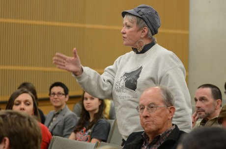 A member of the San Antonio community voices her opinion during the Darwin Day debate held in a Northrup classroom. Photo by Aidan Kirksey.
