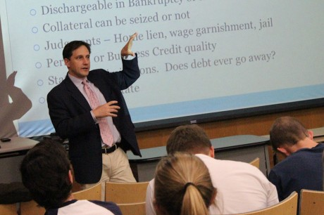Michael Taylor, former bond salesman at Goldman Sachs, teaches a personal finance class with professor of business administration Dante Suarez. Taylor currently writes for Bankers Anonymous, a website that deals with conversations about finance. Photo by Megan McLoughlin.