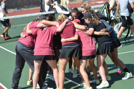 PLayers of the Trinity Tiger's Womens tennis team participate in a traditional group chant before the match against University of Incarnate Word and Texas Lutheran University last Saturday. Photo by Anh-Viet Dinh.