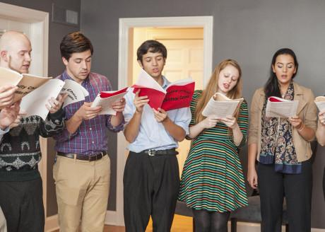 Students sing Christmas carols in Oakmont properties as a part of the Christmas on Oakmont tradition. Christmas on Oakmont will be held this Sunday following Vespers. Photo by Anh-Viet Dinh.