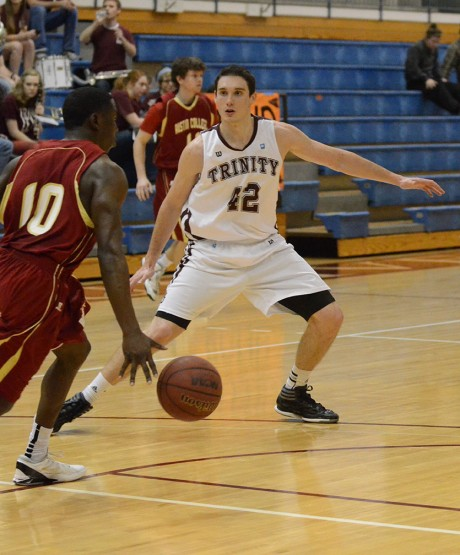 Junior forward Zach Lambert blocks a lay-up by Austin College during last Friday's men's basketball game in Sams Gym. Photo by Megan McLoughlin.