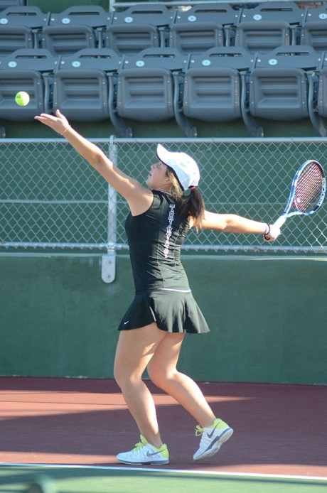 Junior Laura Roa readies to fire a serve at her opponent from Laredo Community College last Saturday. Trinity beat Laredo 9-0. Photo by Matthew Brink.