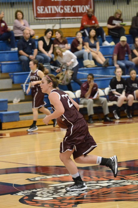 Junior forward Libby Druse carries the ball down court for the Tigers in the game against Southwestern on Feb. 6. Photo Aidan Kirksey.