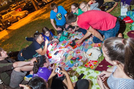 """Students participate in H.O.P.E. Hall's """"sleep-out"""" on the lawn outside Murchison residence hall. Participants slept overnight outside to raise awareness for homelessness. Photo by Anh-Viet Dinh."""