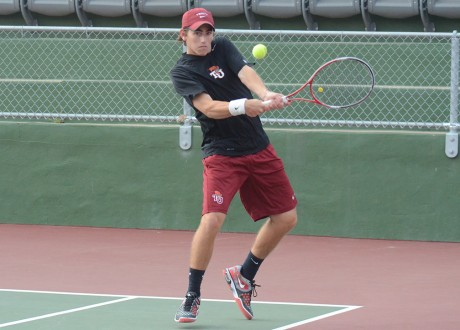 Sophomore captain of the men's tennis team Jordan Mayer hits a backhand during last Friday's tennis match against Kalamazoo College in which the Tigers won 9-0. Photo by Megan McLoughlin.