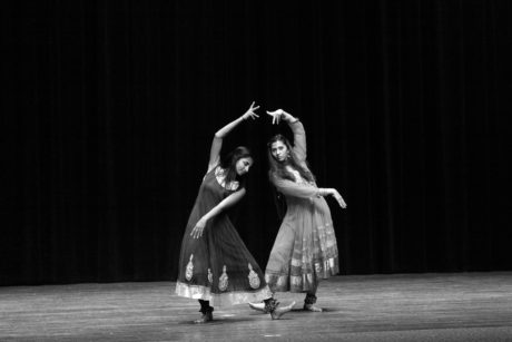 POOJA BOLLAMPALLY and AMULYA CHERALA keep their bodies in sync with each other and shake their ankle bracelets as they dance along to the beat of a